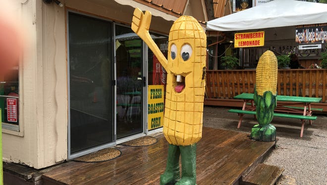The corncob sign in front of a business on Sudderth Drive was vandalized recently but still gives a jaunty wave to passers-by.