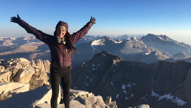 Jessica Crafton celebrates her progress, and the beautiful view, on top of Mount Whitney.