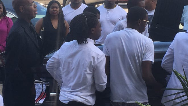 Pallbearers carry the coffin of Elijah Sims, 16, after his funeral in Chicago on Sept. 7, 2016. Sims is among more than 500 homicide victims killed in Chicago thus far in 2016.