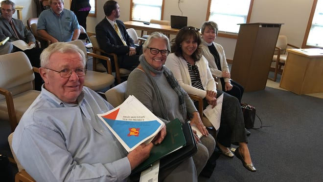(Left to right) Leon Kranz, Pam Tomlin, Luisa Rodriguez, and the Rev. Deacon Laurie Benavides of the High Mountain Youth Project prepare to brief the school board on their plans for a drop-in center for homeless Ruidoso High School students.