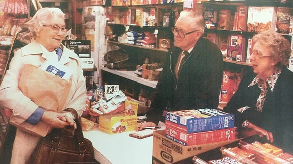Francis Graf (center) and his wife, Lois (right) ran a family grocery store in Platte for four decades.
