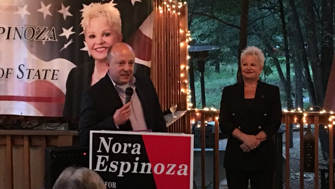 State Rep. Zach Cook introduces colleague and secretary of state candidate Nora Espinoza at a fundraiser at Sanctuary on the River where supporters handed Espinoza a $2,000 check raised selling Paint the State Red salsa.