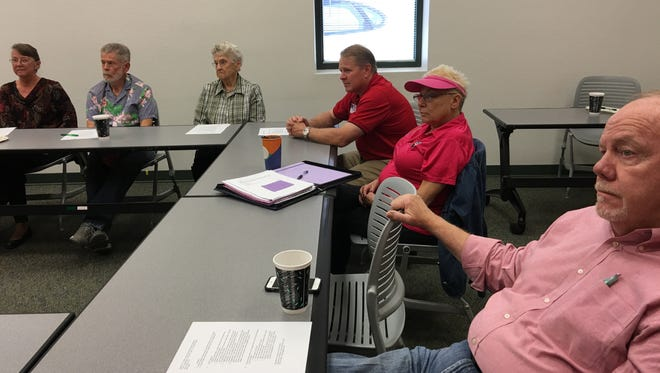 Lincoln County Medical Center Administrator Todd Oberheu (center, in dark red shirt) briefs the Creative Aging Advisory Committee on the upcoming hospital bond issue.