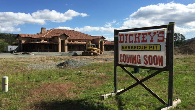 The new Dickey's BBQ promised in this sign across U.S. 70 from Walmart is expected to open in December.