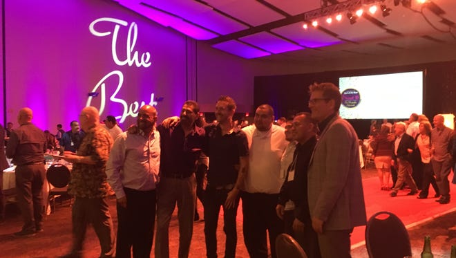 Workers from the Arrive Palm Springs hotel pose for photos Tuesday night during the 16th annual Best of the Best Awards at the Palm Springs Convention Center.