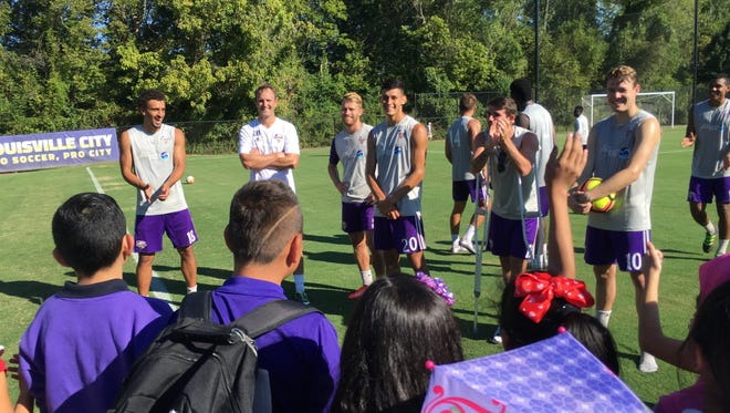 Louisville City FC players speak to students from Fairdale Elementary School's English as a Second Language program.