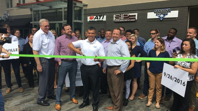 UST Logistical Systems' four partners cut a ribbon signifying the opening of their new headquarters in Greenville.