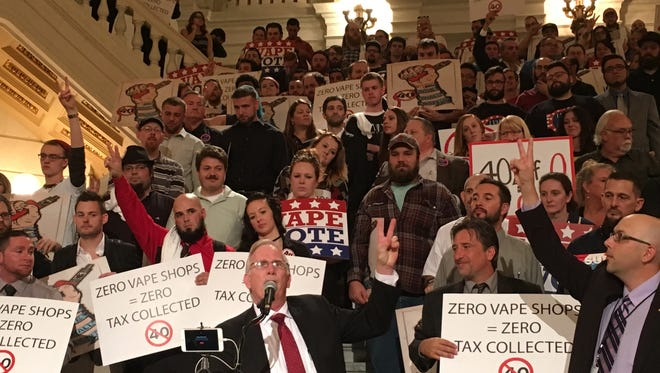 """Chuck Huff,  administrator of Pennsylvanians Against Vape Tax, holds up a """"V"""" for vaping at the Harrisburg vape tax rally Sept. 26"""