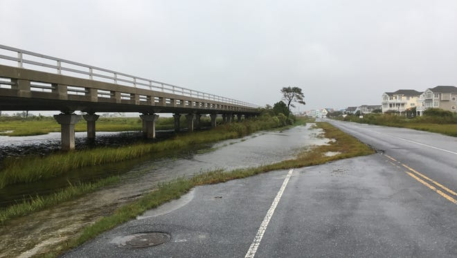 The old Route 54 road near Fenwick Island gathers water from the marshes as travelers are high and dry heading toward the beaches on Thursday, Sept. 29.