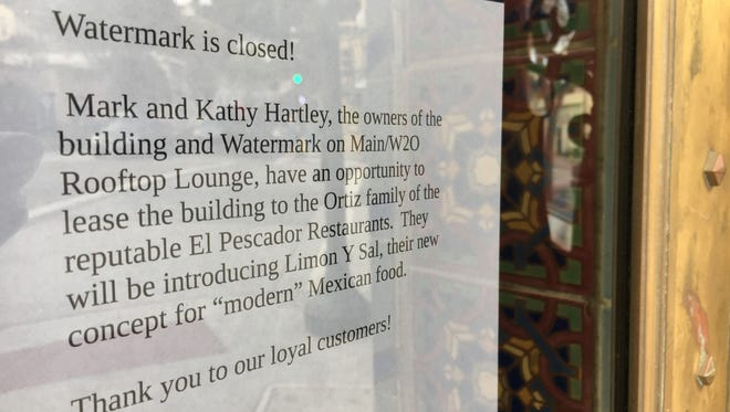 A sign taped to the front doors at Watermark on Main alerts patrons to the restaurant's closure, and to the name of the incoming tenant: Limon y Sal.