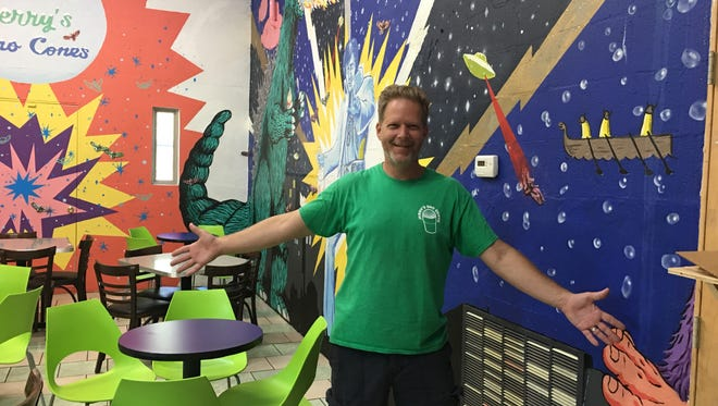 David Acklin, owner of Jerry's Sno Cones, opens an addition for indoor seating on Friday.