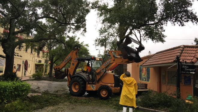 Cocoa Public Works workers were removing fallen tree limbs and other debris just after Hurricane Matthew moved away on Friday.