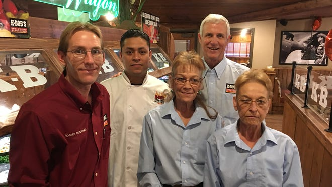 Ruidoso K-BOB'S owner Ed Tinsley poses with four of his five-member management team, (l-r) Robert Padovano, Omar Espinoza, Brenda Brooks and Jody Ryen. G.M. Leticia Espinoza had to rush off to the hospital to greet a new grandchild.