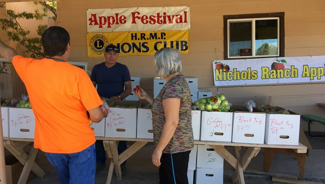 Bob Nichols of Nichols Ranch and Orchard in La Luz offered many varieties of apple for sale at the High Rolls Apple Festival, and anyone who needed a taste to see which one they wanted got free bites.