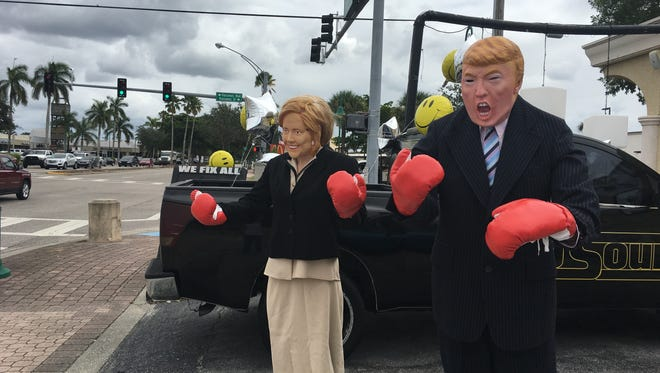 Auto Sound in Cape Coral put out mannequins that resemble 2016 presidential candidates Hillary Clinton and Donald Trump. The duo are wearing boxing gloves.