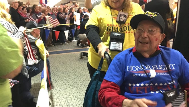 Dudley Riley, a WWII veteran, receives a hero's welcome at Evansville Regional Airport on Saturday.