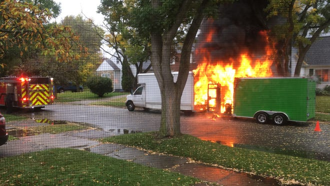 A truck and trailer caught fire in Lansing on the 1600 block of Park Avenue on Wednesday afternoon.