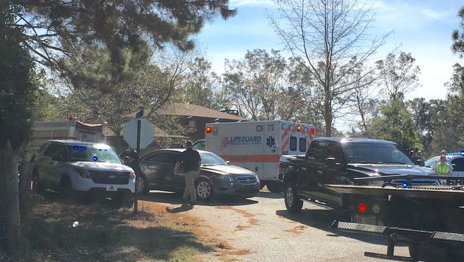 Law enforcement investigate a brief car chase and wreck that led to the arrest of one burglary suspect in Lamar County.