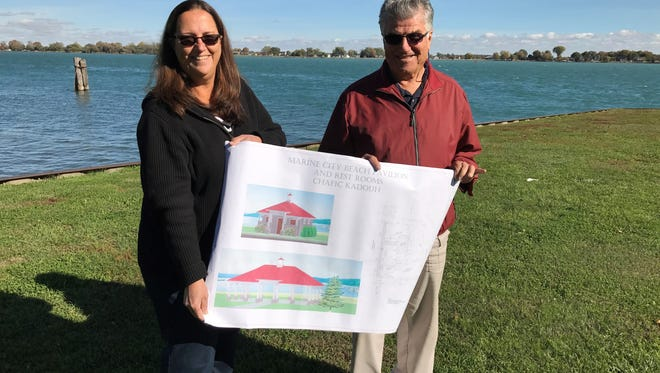 Denise and Chafic Kadouh stand with blueprints of the pavilion they plan to donate to the city on Oct. 28, 2016.