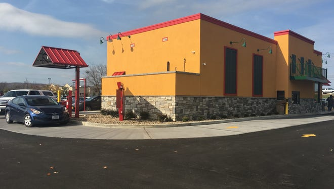 Cars advance through the drive-thru line at Popeyes Louisiana Kitchen, which opened Monday in Big Flats.