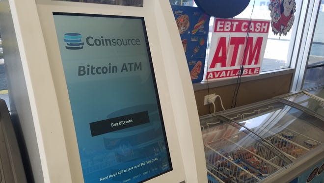 The Coinsource bitcoin ATM at Oxnard Gas and Mart is open 24 hours a day. The machine allows customers to exchange cash for bitcoins.