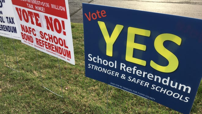 Campaign signs outside John Jones Automotive Outlet in Greenville advertise for and against an $87 million referendum to fund school building improvements in Floyd County.