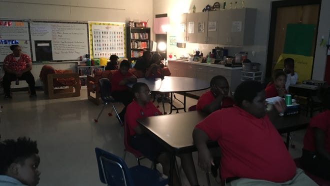 Sixth-grade students from Jackson Career and Technology Magnet School listen to Jackson Sun photographer Kenneth Cummings at the school's first career day.