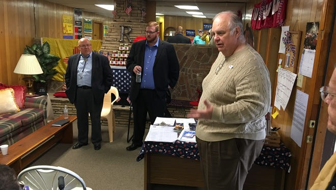 Former state GOP chair John Billingsley introduces state Sen. Bill Burt, left, and 12th District Attorney John Sugg, center, at the party's final weekly candidate meet-and-greet Friday.
