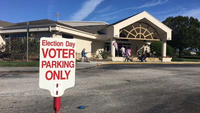 A steady stream of voters arrives at Suntree United Methodist Church Tuesday morning.