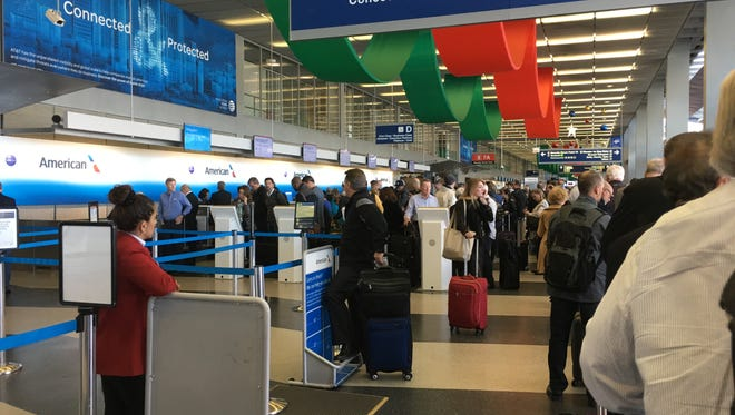 Lines snaked through an American Airlines check-in area at Chicago O'Hare after an apparent glitch disrupted the reservations systems of American and at least two other airlines.