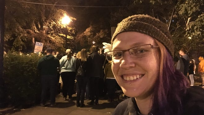 """Joy Camacho, 34, of Knoxville, organized """"Love Trumps Hate Rally"""" using social media. About 200 people marched downtown Saturday night."""
