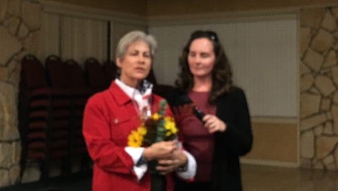 Ann Eby, left, accepts a floral tribute for her hard quadrennial year work organizing GOP events and coordinating election efforts.