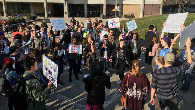 Montclair State University students and faculty march through campus protesting the election and policies of President-elect Trump on Wednesday, Nov. 16.