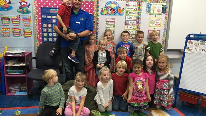Veteran Adam Reguli in Kristi Radford's class for North Stewart Elementary's Veterans Day celebration.