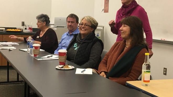 Clara Farah, standing, chair of the Creative Aging Advisory Committee, introduces panelists Jennifer Chadwick, Matt Thompson, Maryah Romans, and Beth Miller.