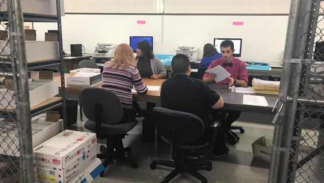 Election officials recount ballots from Assembly District 31 in North Sparks on Monday, Nov. 21. Republican Jill Dickman requested a recount after a close 38-vote loss to Democrat Skip Daly.