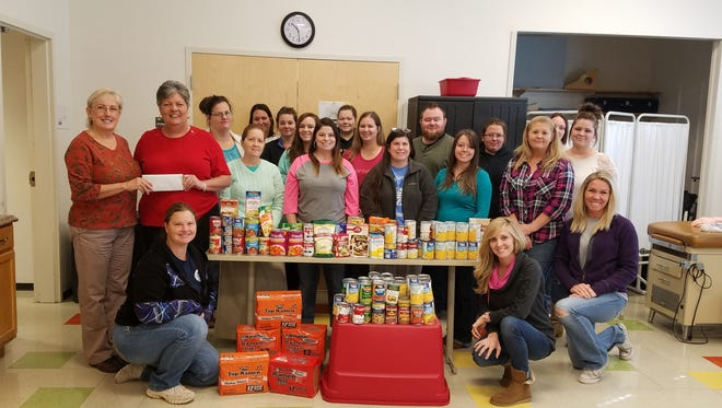 ASH FLAT – Earlier this month, Ozarka College LPN students hosted a free mini-health fair in Ash Flat. They also collected non-perishable food items and monetary donations for the Mission of Hope food bank. Shown are Ozarka College-Ash Flat LPN students as they donate $26 and several non-perishable food items to Julia Balderidge from Mission of Hope food bank.