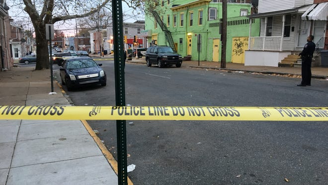 Wilmington police investigate a reported shooting along North Van Buren Street in Wilmington on Thanksgiving Day.