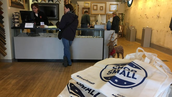 File photo: Shoppers explore Gordy Fine Arts and Framing in downtown Muncie during Small Business Saturday in 2016.
