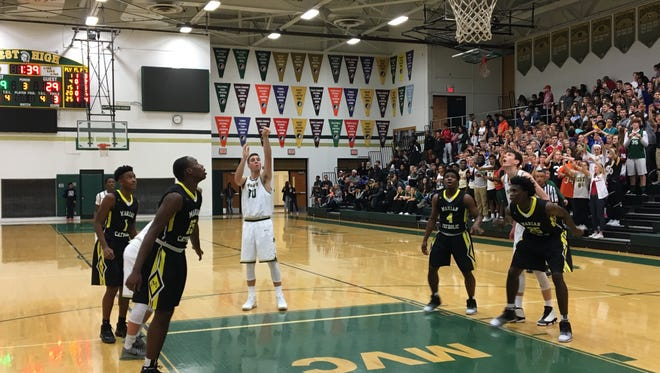Connor McCaffery shoots a free throw during Iowa City West's season-opener against Marian Catholic (Chicago Heights).