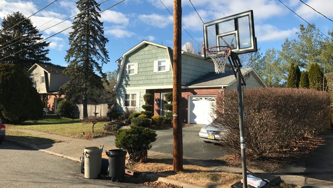 Borough ordinance would prevent residents from leaving any basketball hoop stands, portable or permanent on sidewalks or streets. All hoops, such as the one pictured on Albany Avenue, on Dec. 5, 2016, must be removed following each use.