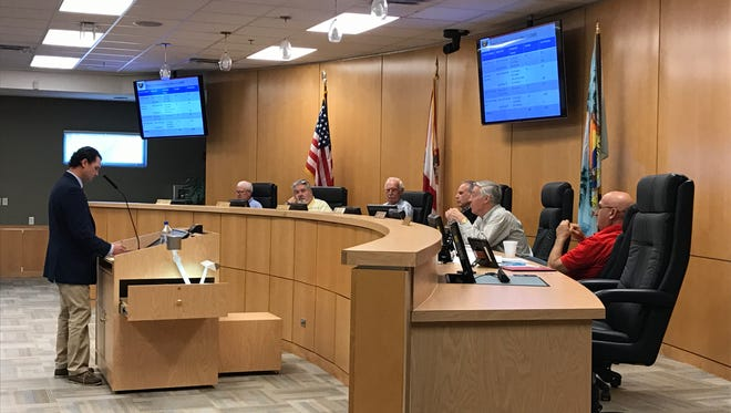 """Richard Cannone (left) of Calvin, Giordano and Associates, Inc. presents the list of 33 """"glitches"""" within the city's Land Development Code to the Planning Board on Friday, Dec. 2, 2016."""