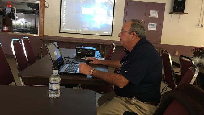 Bob Fishel of National Meter and Automation Inc. demonstrates Ruidoso's new water monitoring system at a training session Monday.