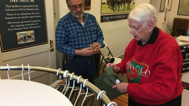 Fort Stanton Inc. secretary Dorothy Rogers and fellow volunteer John Zaldivar unpack t-shirts and other merchandise as the Fort Stanton Museum gift shop prepares for its official reopening celebration next week.
