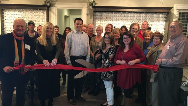 The Huron Valley Chamber of Commerce hosted a ribbon-cutting at Heinsight Eyecare.