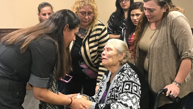 Defense lawyer Gabi Canales (left) tells Ray Rosas' mom her son will be going home after he was acquitted Tuesday, Dec. 13, 2016, at the Nueces County Courthouse.