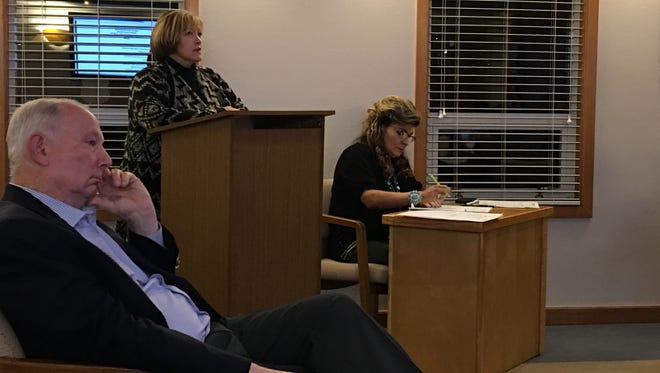 Local teachers union head Lisa Vasquez took the podium Tuesday to protest a state rule change on teacher evaluations.