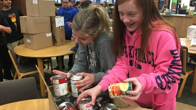 Canned goods were packed into boxes for the Salvation Army food pantry.