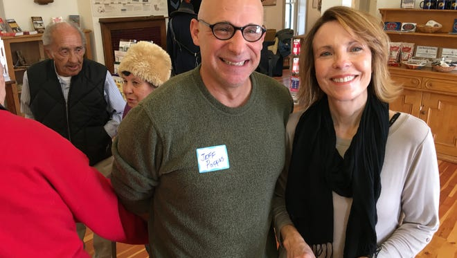 Jeff Pappas, head of the state Historic Preservation Office, chats with Lincoln County Commission Elaine Allen at a reception Wednesday at Fort Stanton.