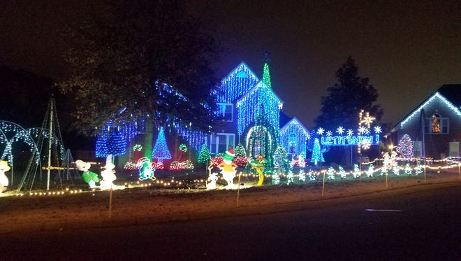 Mike Willis's Christmas lights dance to music on Laurens Way North in Hendersonville.